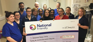 National Friendly staff and NICU nurses hold large cheque