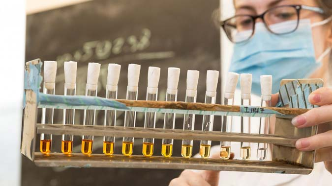 Researcher conducting chemical tests
